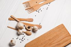 Fresh sliced garlic in glass bowl on wooden background.  Royalty Free Stock Photos