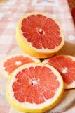 Fresh sliced grapefruit on the table Stock Photography