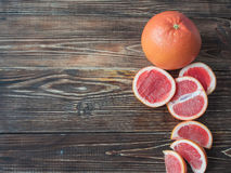 Fresh and sliced grapefruit on wooden background, with space for text. stock photos