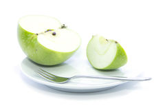 Fresh sliced green apple diet food on white plate Royalty Free Stock Photos