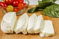 Fresh sliced halloumi cheese from Cyprus on a wooden board. Surface Royalty Free Stock Image