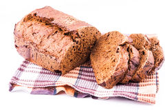 Fresh sliced homemade brown bread with cereals on a kitchen towel Royalty Free Stock Photo