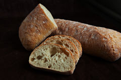 Fresh sliced italian Ciabatta bread on background Stock Photo