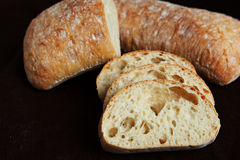 Fresh sliced italian Ciabatta bread on background Stock Image