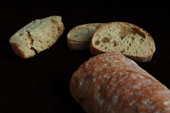 Fresh sliced italian Ciabatta bread on background Stock Images