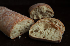 Fresh sliced italian Ciabatta bread on background Royalty Free Stock Images