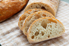 Fresh sliced italian Ciabatta bread on background Royalty Free Stock Photo