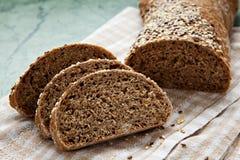 Fresh sliced italian Ciabatta bread on wooden background Stock Image