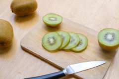 Fresh sliced kiwi fruit and knife. On cutting board Royalty Free Stock Photography