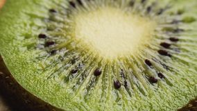 Sliced kiwi fruit. Fresh sliced kiwi fruit rotating and zooming out. Closeup macro shot. Fresh berry series stock footage