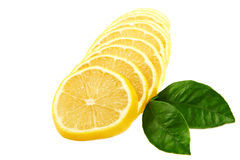 Fresh sliced ​​lemon and green leaves. Royalty Free Stock Photo