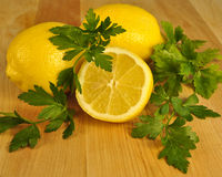 Fresh sliced lemon and green parsley. Royalty Free Stock Images