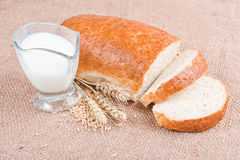 Fresh sliced loaf with bran and milk Royalty Free Stock Images