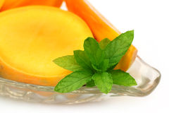 Fresh sliced Mango with mint Stock Image