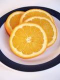 Fresh sliced Orange. An orange sliced on a plate Stock Images
