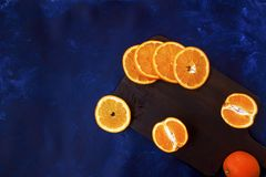 Fresh sliced oranges on wooden board stock image