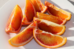 Fresh sliced Organic Blood Oranges on a plate Royalty Free Stock Photo