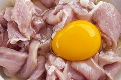 Fresh sliced pork with raw egg yolk. Raw egg yolk and albumen on fresh sliced pork prepare for cooking Stock Photography