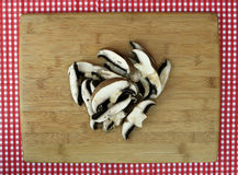 Fresh Sliced Portabella Mushrooms on Cutting Board Royalty Free Stock Images