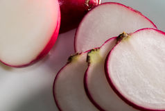 Fresh sliced radish on white background. Fresh sliced radish. Red radish Royalty Free Stock Photos