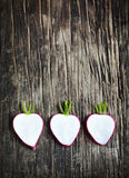 Fresh sliced radish on wooden background. With copy space Royalty Free Stock Photography