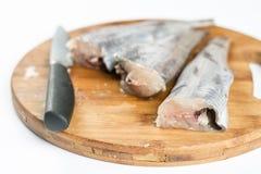 Fresh sliced raw hake fish on the cuting board.  Royalty Free Stock Image