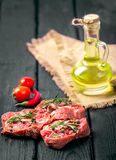 Fresh sliced raw meat on a wooden cutting board. With spices and onions Stock Photography
