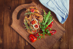 Fresh sliced raw meat on a wooden cutting board. With spices and onions Stock Image