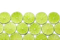 Fresh sliced ripe limes on white background , top view. Fresh sliced ripe limes on white background, top view stock image