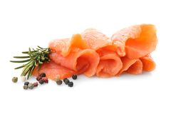 Fresh sliced salmon fillet with rosemary and pepper mix. On white background royalty free stock photos