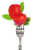 Fresh sliced strawberry on fork Royalty Free Stock Photos