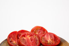 Fresh sliced tomatoes. On paper plate whole tomato homegrown on white stock images