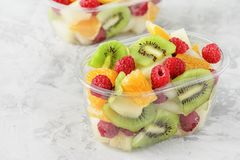 Free Fresh Sliced Tropical Fruits Berries In Container Stock Photography - 153387972