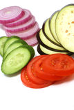 Fresh sliced vegetables. Fresh sliced cucumbers tomatoes onion and egg-plant Stock Photography