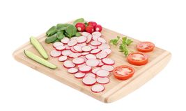 Fresh sliced vegetables on cutting board. Stock Photography