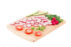 Fresh sliced vegetables on cutting board. Stock Photo