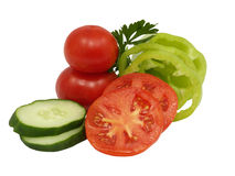 Fresh sliced vegetables.Isolated. Fresh sliced cucumber, green pepper and tomato on a white background Royalty Free Stock Images