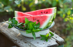 Fresh sliced watermelon. In a white bowl outdoors Stock Photo