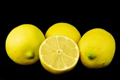 Fresh sliced and whole lemons royalty free stock images