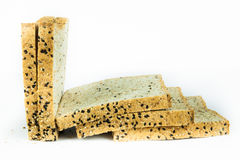 Fresh sliced wholewheat bread with various seeds and multigrain. On isolated white background Stock Images