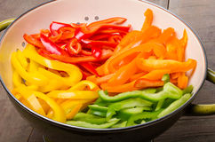 Fresh slices of bell peppers in different colors Royalty Free Stock Images