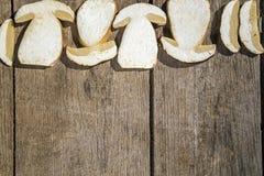 Fresh slices of Boletus Edilus mushrooms on a wooden table Stock Photos