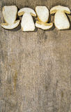 Fresh slices of Boletus Edilus mushrooms on a wooden table Stock Photography