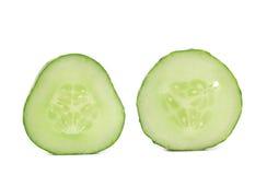 Fresh slices of cucumber on white background. Fresh slices of cucumber on a white background Stock Photos