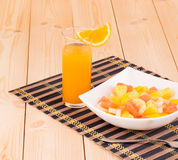 Fresh slices of fruits on plate with juice. Stock Image