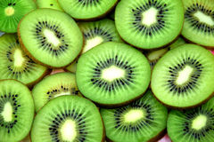 Fresh slices of kiwi fruit background. Royalty Free Stock Photos