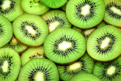 Fresh slices of kiwi fruit isolated on white Stock Photos