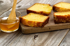 Fresh Slices of Lemon Cake and honey on wood server Royalty Free Stock Photos