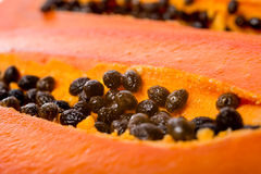 Fresh slices papaya seeds in the fruit Stock Images