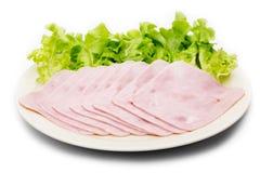 Fresh slices of pork ham on plate Royalty Free Stock Photo